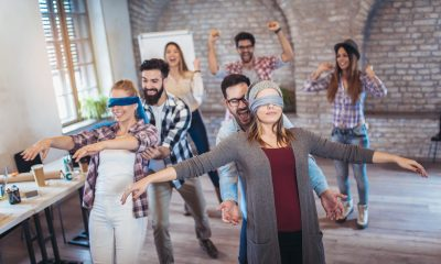 workplace office trust falling blindfolded catching