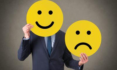 businessman happy sad