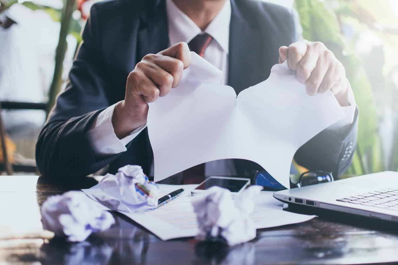 businessman tearing up contract
