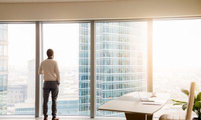 ceo looks out of skyscraper window