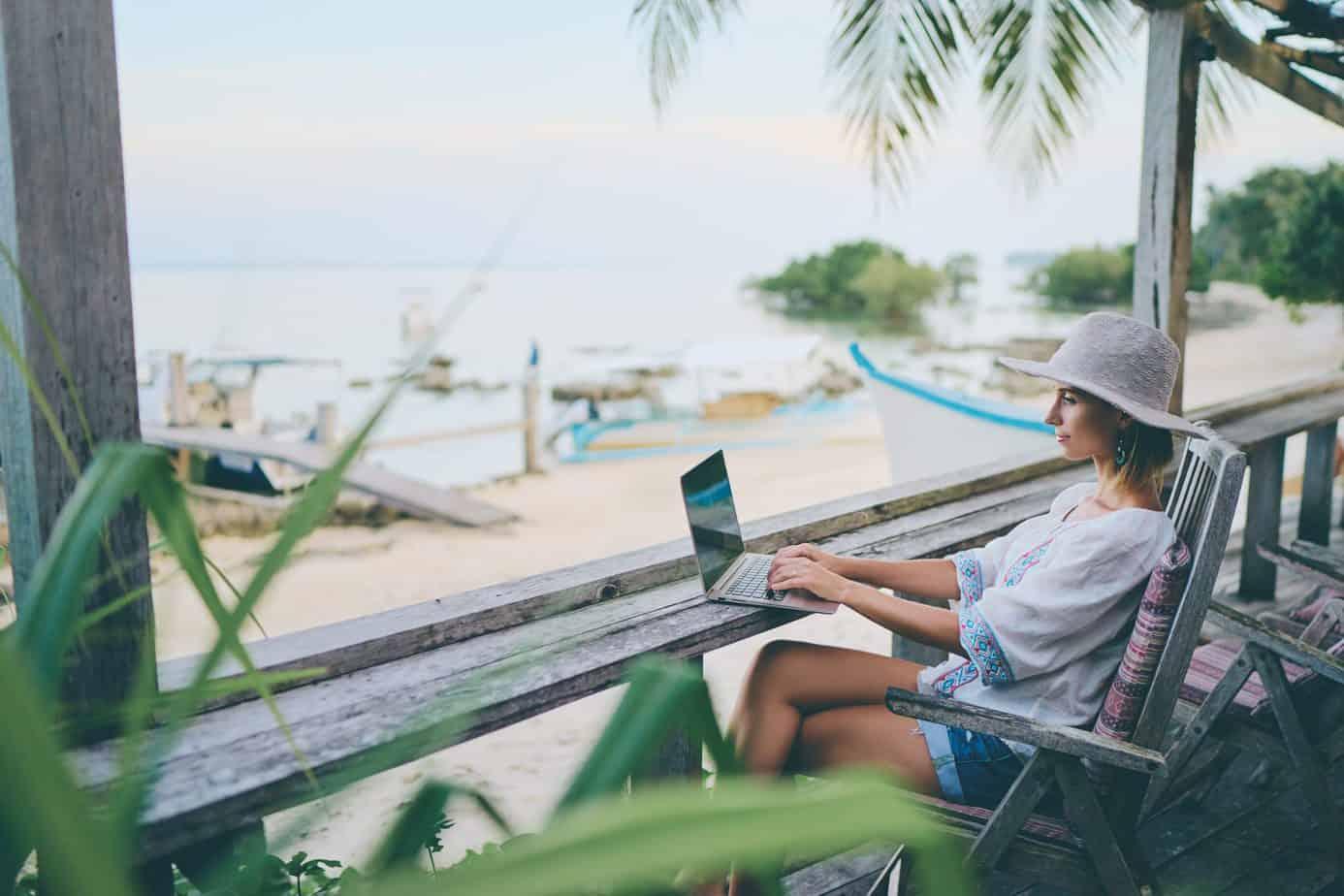 freelancer working on beach