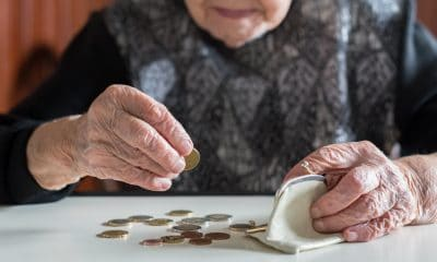 pensioner counting coins