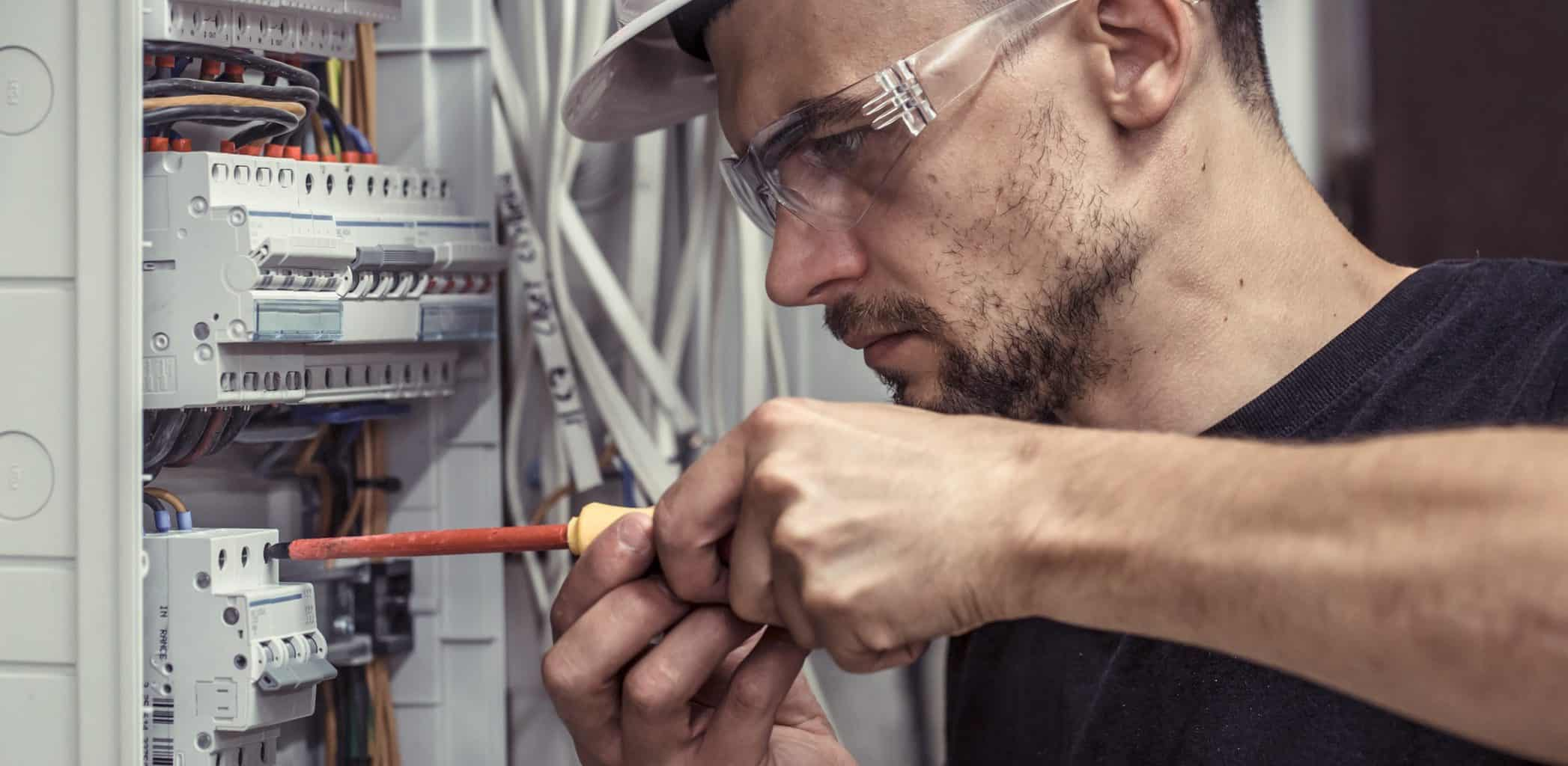 electrician working on a fuseboard