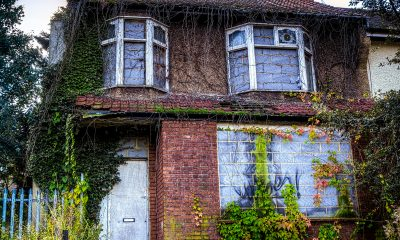 run down abandoned semi detached house